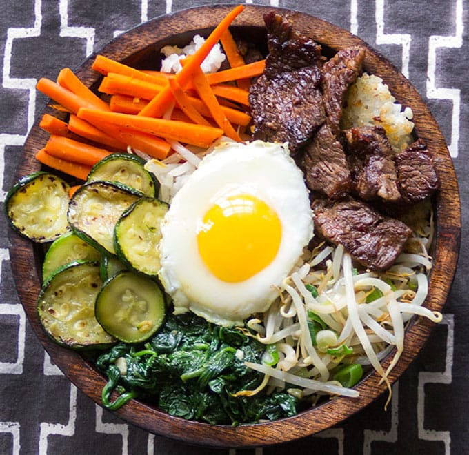 Bibimbap • Korean rice bowl with marinated beef, seasoned vegetables, fried egg and delicious spicy sauce • Panning The Globe