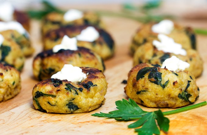 A Knish is one of the best food inventions ever! Try making this Mini Spinach Potato Knish Appetizer at home. The recipe is easy and these little baked puffs of mashed potato, caramelized onion and spinach are amazingly delicious.