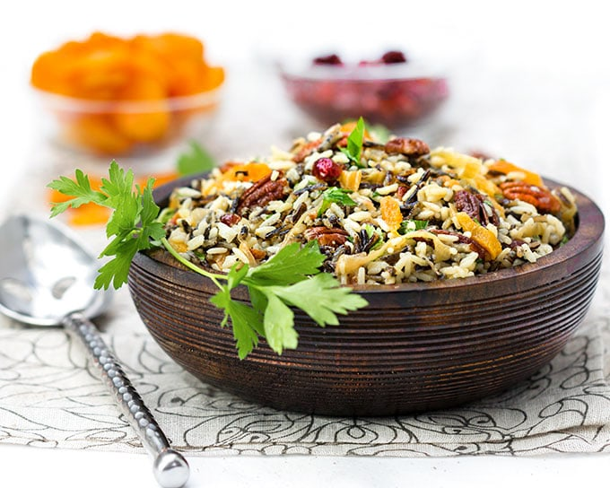 This wild rice salad is bejeweled with cranberries, apricots and pecans and dressed with orange shallot vinaigrette. It's a great holiday side dish recipe.