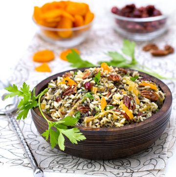 This wild rice salad is bejeweled with cranberries, apricots and pecans and dressed with orange shallot vinaigrette. It's The perfect side dish for Thanksgiving or any festive meal.