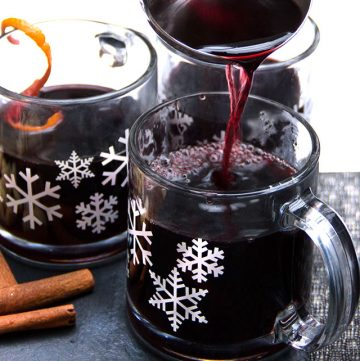 snowflake mugs filled with Swedish Glögg. delicious hot spiced mulled wine and spirits