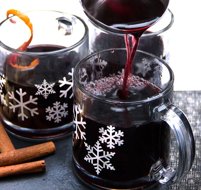 snowflake mugs filled with Swedish Glögg, delicious hot spiced mulled wine