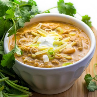 It's easy to cook a big pot of this award winning white chicken chili, and it's the absolute BEST white chicken chili! Tender chicken, chilies, white beans, spices and a few more goodies in this winning white chicken chili recipe.