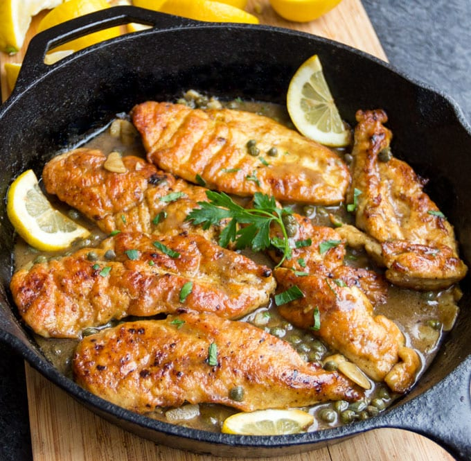 How to make chicken piccata in one pan, tender boneless chicken in a luscious lemony sauce with capers and parsley.