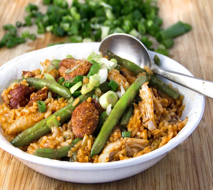 Spicy chicken jambalaya is the BEST New Orleans party food, perfect for feeding a crowd during Mardi Gras or for family and friends anytime. This jambalaya recipe is easy to cook at home and includes nutritious green beans for a well-rounded one pot dinner.