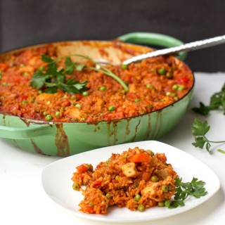Jollof Rice is a delicious casserole of chicken, rice and vegetables in a mild tomato curry sauce. It's a great dish for the whole family, a healthy balanced meal in one pot, full of interesting flavors yet mild enough to be pleasing even to those with picky palates. (gluten-free, dairy-free recipe)