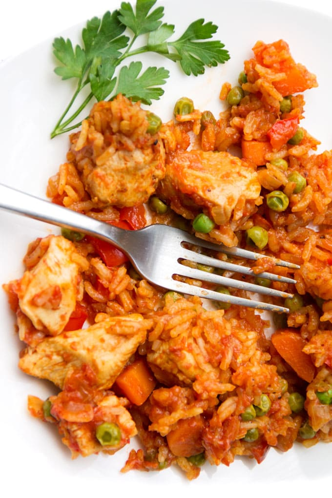 Jollof Rice with Chicken from Ghana • a delicious family-friendly chicken and rice casserole