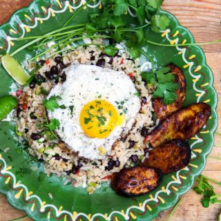 Gallo Pinto isthe national breakfast of Costa Rica. Flavorful rice, beans and aromatic vegetables are topped with eggs and served with caramelized plantains on the side. It makes a sensational breakfast or brunch and it's hearty enough for lunch or dinner. Recipe | panningtheglobe.com