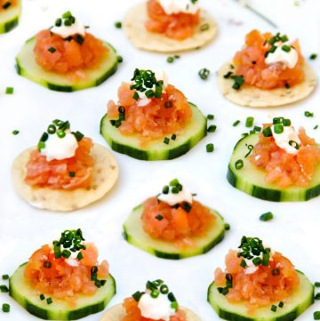 Smoked Salmon Tartare: An easy elegant appetizer in ten minutes. A total crowd pleaser. Serve on cucumber rounds and rice crackers. Top with sour cream and chopped chives