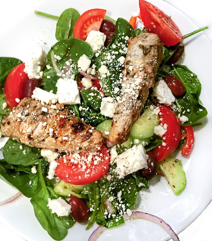 Greek spinach salad topped with lemon garlic marinated grilled turkey tips and cubes of salty feta is a fabulous, healthy weeknight dinner recipe.