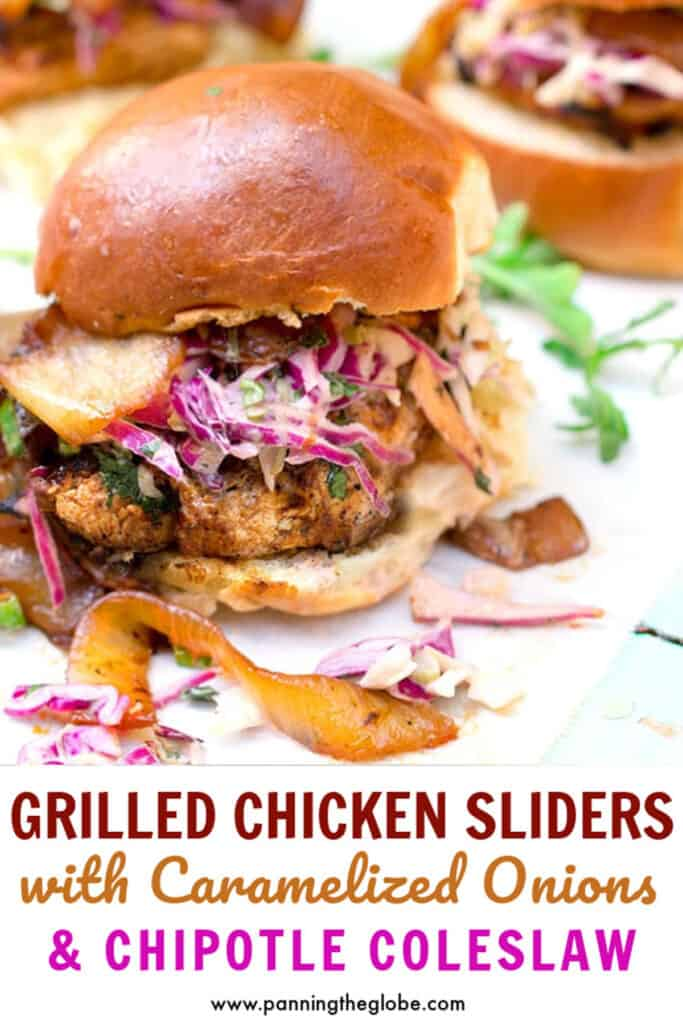 bbq chicken slider on a bun with coleslaw and caramelized onions falling out of it