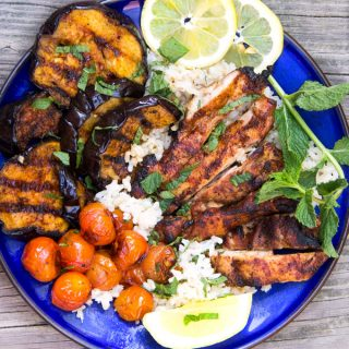 Grilled Harissa Chicken Rice Bowl with Glazed Eggplant, sweet and spicy! An easy recipe featuring Harissa, North Africa's addictively delicious chili paste.