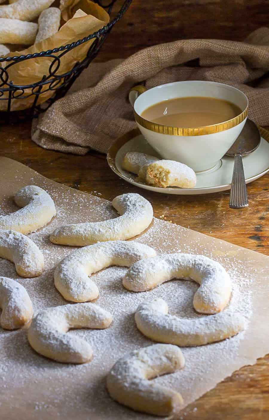 8 almond crescent cookies and a cup of coffee