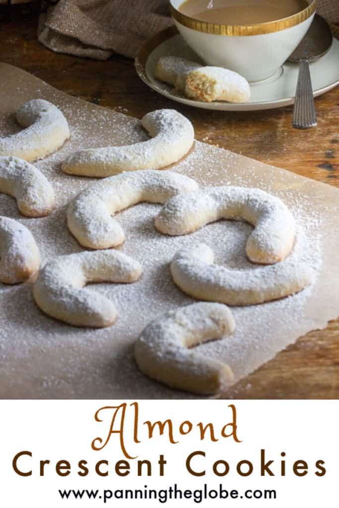 Pinterest pin: almond crescent cookies on a piece of parchment