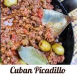 cuban picadillo (ground beef stew) in a black skillet