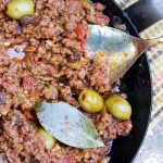 Cuban Picadillo is a sweet and sour ground beef stew in a flavorful tomato sauce with vinegar, onions, garlic, olives and smoked paprika. The recipe is quick and easy, 35 minutes start to finish. Serve Picadillo over mashed potatoes, rice or quinoa to soak up all the delicious sauce.