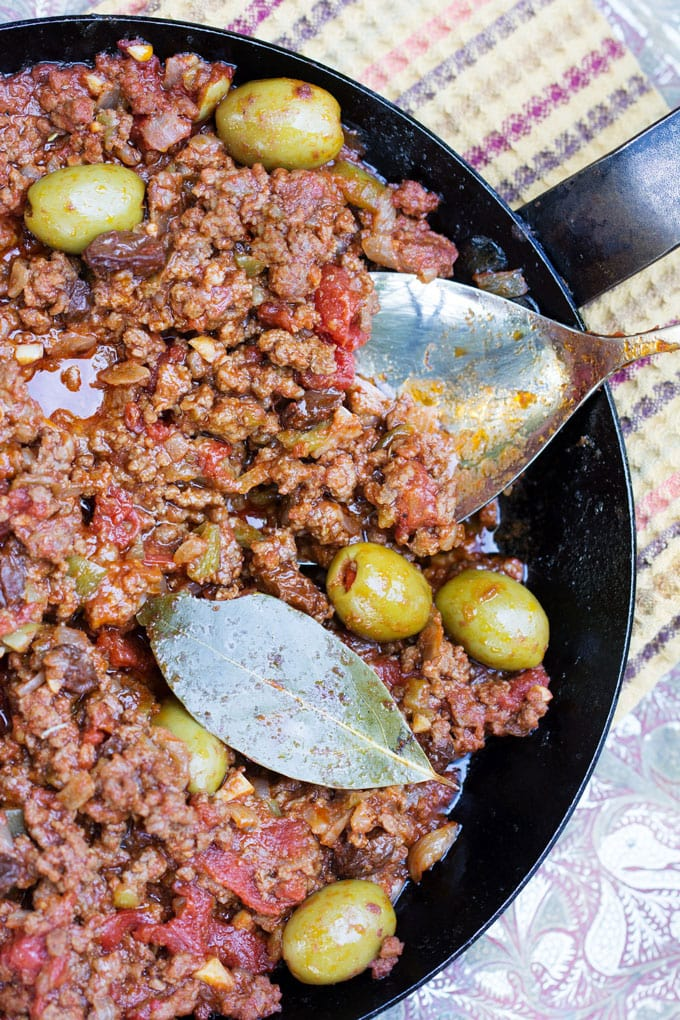 Cuban Picadillo: Ground beef stew, in the pot garnished with green olives