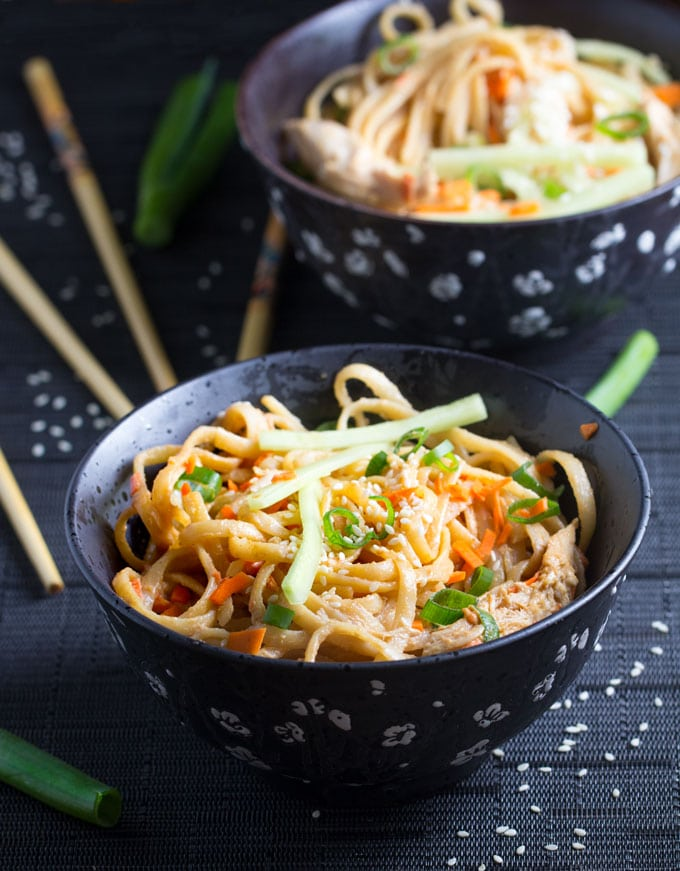 Here's an easy recipe for spicy sesame peanut noodles with chicken and vegetables. It takes just 30 minutes to get this Chinese favorite on the table l www.panningtheglobe.com