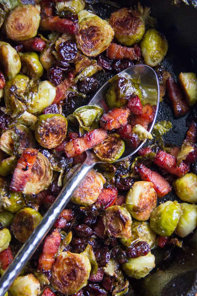close up of brussels sprouts with bacon and dried cherries