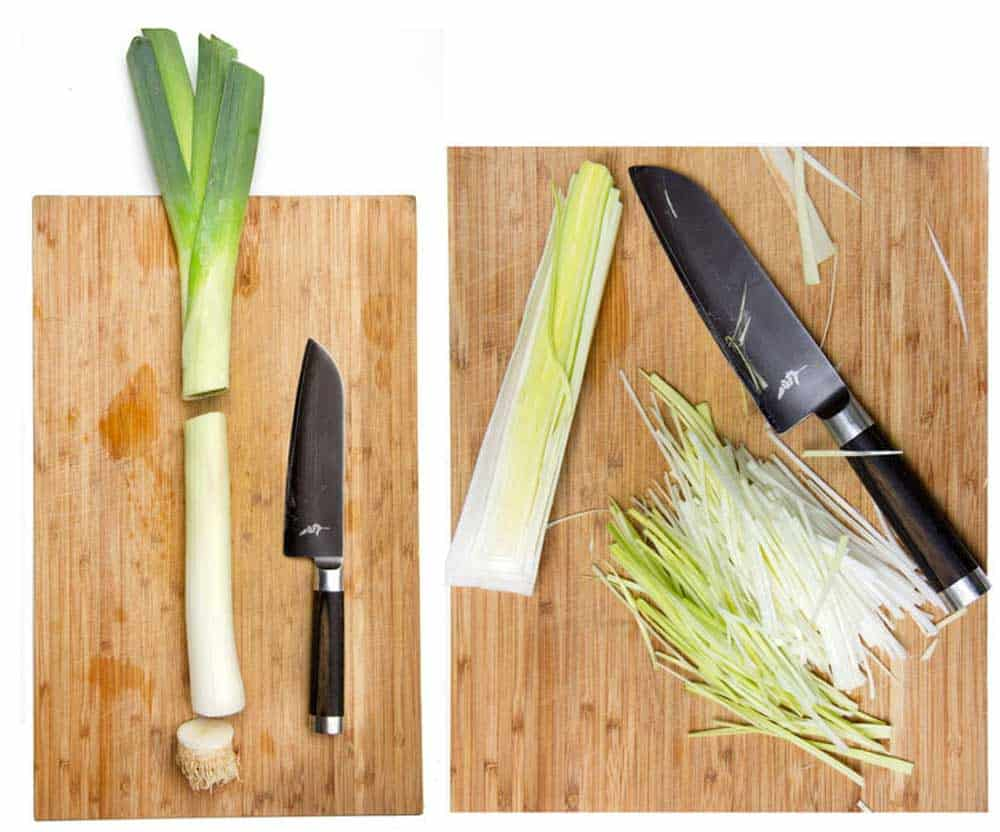 leeks and a knife on a cutting board, and slivered leeks on a cutting board