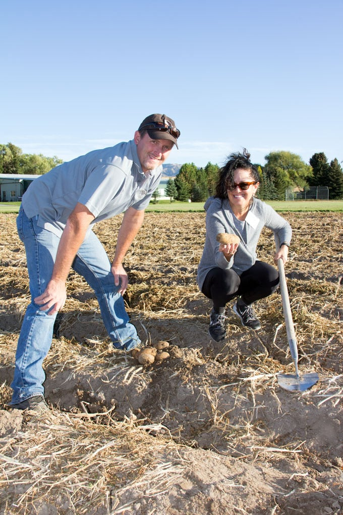 Lisa Goldfinger with James Hoff, digging potatoes on Hoff Brother's Farm, Idaho Falls, Idaho