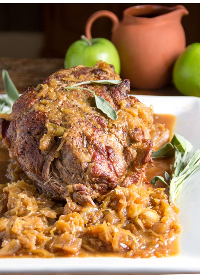 Pork Roast with Sauerkraut Apples and Onions is a delicious festive dish that takes only 5 ingredients and 20 minutes of prep. It's easy enough for Sunday dinner and special enough for New Year's Eve.
