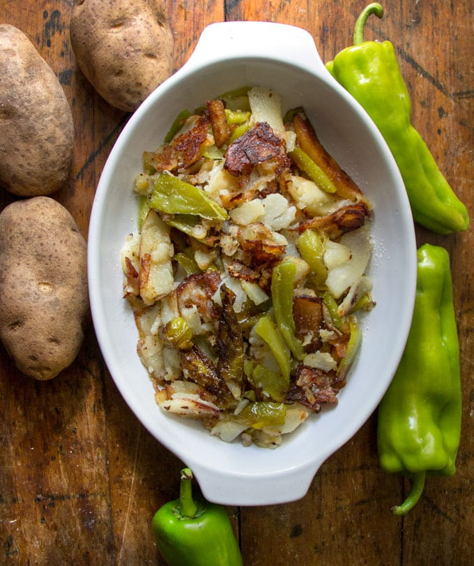 These are the most delicious fried potatoes ever. Parts are crisp and brown, other parts are tender and creamy. The peppers add beautiful flavor. Don't put them on the table until you're ready to see them disappear!