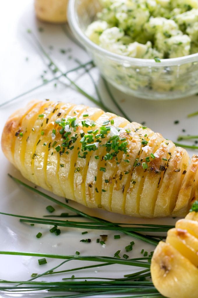 Holiday Hasselback Potatoes are the perfect holiday side dish, especially when they're basted with shallot chive butter while they cook!