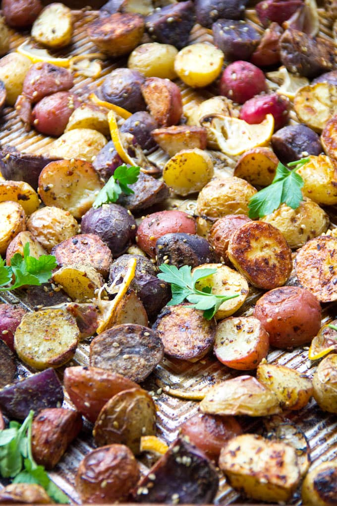 These colorful roasted potatoes are deliciously crisp on the outside and creamy inside. The amazing flavors of Middle Eastern za'atar, red pepper and fresh lemon, are baked in. They're extra good drizzled with lemony tahini sauce.