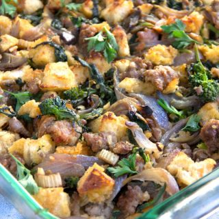 This Italian sausage stuffing is livened up with broccoli rabe, garlic, hot paprika, onions, celery and parmesan cheese. This rustic spicy, savory stuffing is perfect for Thanksgiving.