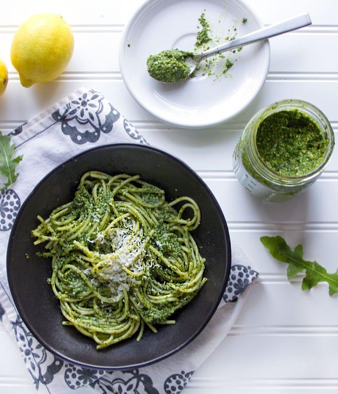 Spaghetti with bright green Arugula Pesto and parmesan cheese
