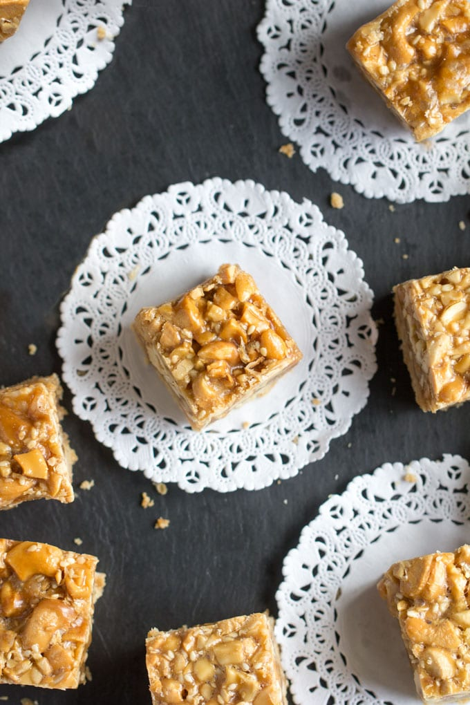 Sesame Cashew bars with caramel and shortbread on lace doilies