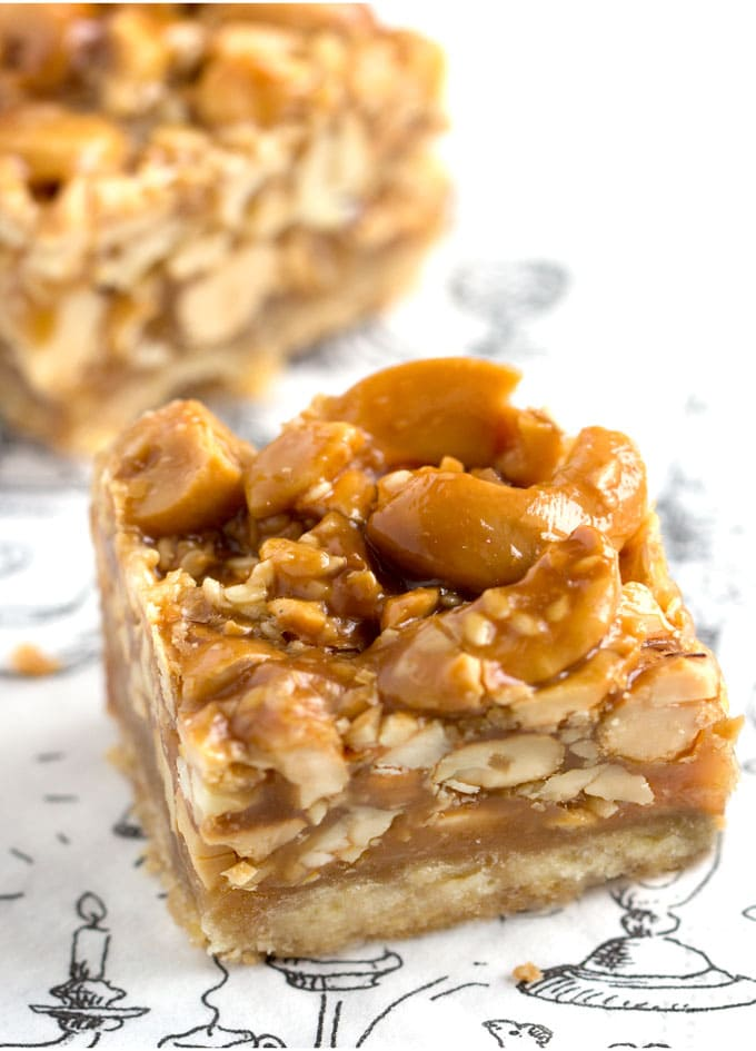 These Sesame Cashew bars are out of this word: luscious caramel with nuts and sesame seeds on top of a rich shortbread crust. They're the best seller at Sofra Bakery and now you can make them at home. Plus, they keep for two weeks, so you can make them ahead for your party or for delicious holiday gifts.