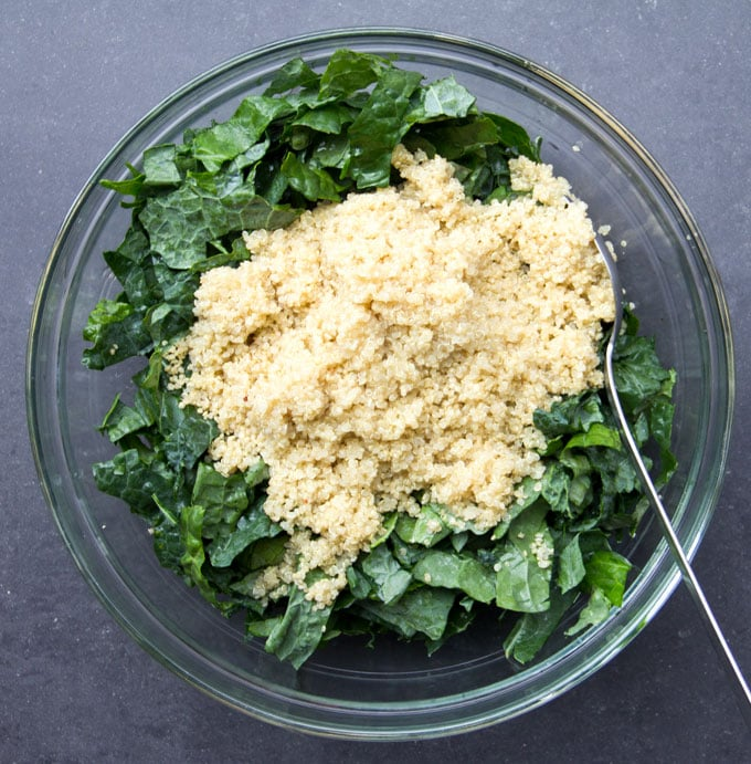 raw kale with hot quinoa on top to soften it