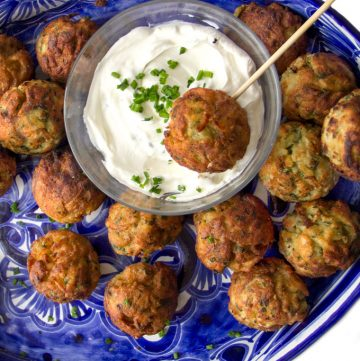 These Savory Potato Aebleskivers are potato pancakes like you've never had them before. The batter is made from tender red lentils, shredded potatoes, herbs and chilies. The pancakes are cooked in a special pan that forms them into golden brown spheres that are crisp on the outside, fluffy and tender inside. Serve these scrumptious bites as a party appetizer or a game day snack. As a bonus, these potato aebleskivers are gluten-free, dairy-free, and egg-free.
