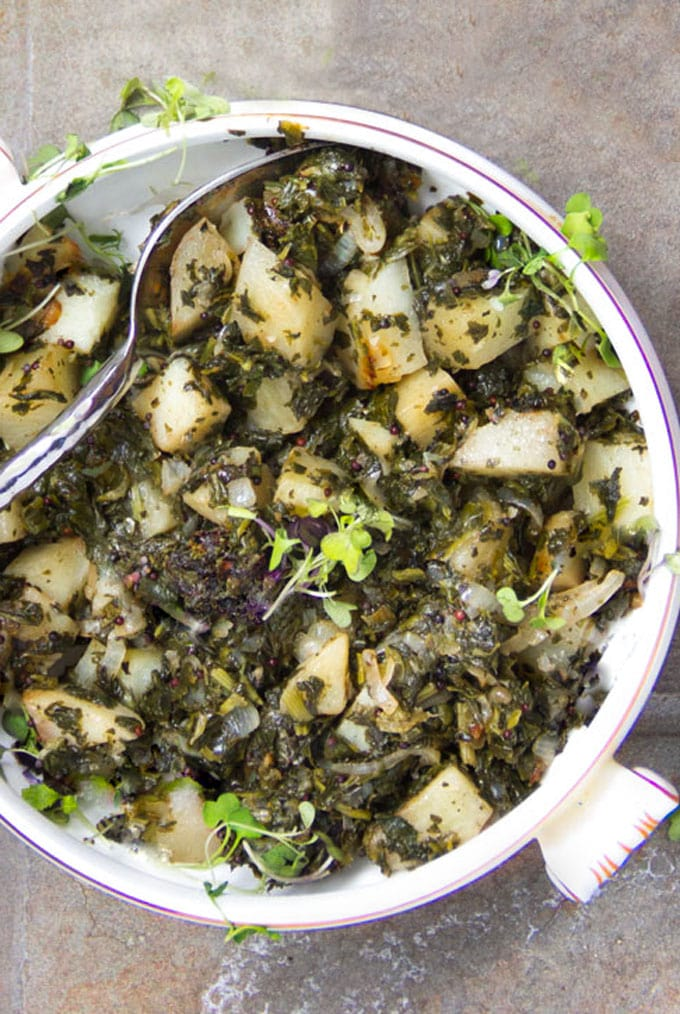 Delicious Indian Saag Aloo, spinach and potatoes, is easy to cook at home. It's a fantastic healthy side that comes together quickly, with only two main ingredients plus onions, garlic and spices I panningtheglobe.com