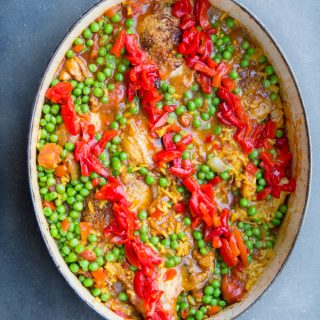 Arroz Con Pollo is Spain's beloved chicken and rice casserole. It's the best chicken and rice casserole recipe and easy to make at home. A one pot wonder with tender chicken and yellow rice in a scrumptious sauce of tomatoes, aromatic vegetables, and spices.