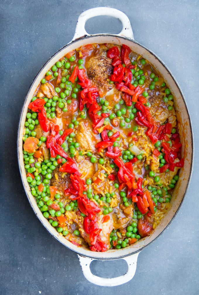 Arroz Con Pollo is Spain's beloved chicken and rice casserole. It's the best chicken and rice casserole recipe and easy to make at home - a one pot wonder with tender chicken and yellow rice in a scrumptious sauce of tomatoes, aromatic vegetables and spices.