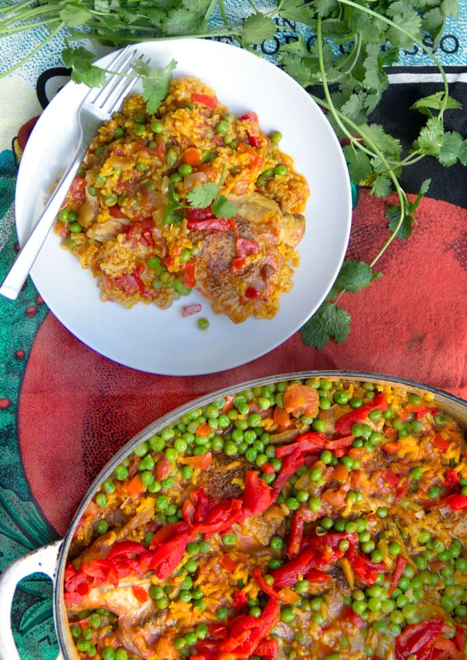 Arroz Con Pollo is Spain's beloved chicken and rice casserole. It's the best chicken and rice casserole recipe and easy to make at home. A one pot wonder with tender chicken and yellow rice in a scrumptious sauce of tomatoes, aromatic vegetables and spices.