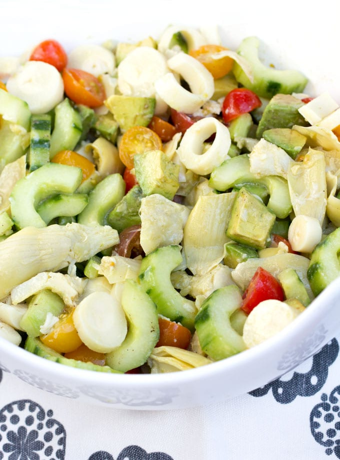 This Brazilian-style hearts of palm salad has rich flavors and an exotic quality about it, yet it's a healthy and easy recipe to throw together. Just some slicing and dicing and a wonderful lemony, mustardy, garlicky dressing that brings it all together.