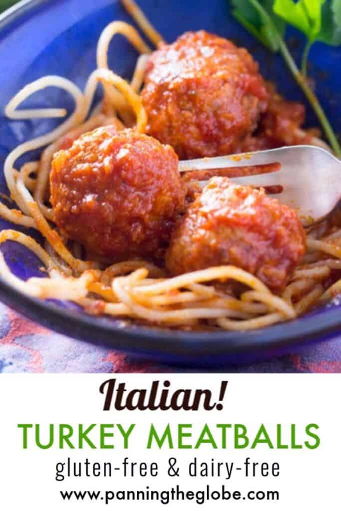 3 Italian turkey meatballs with spaghetti in a blue bowl