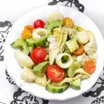 bowl with hearts of palm salad with cucumbers, artichoke hearts and cherry tomatoes