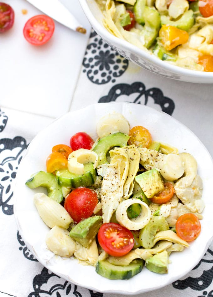 hearts of palm salad with artichoke hearts, cucumbers, avocados and cherry tomatoes