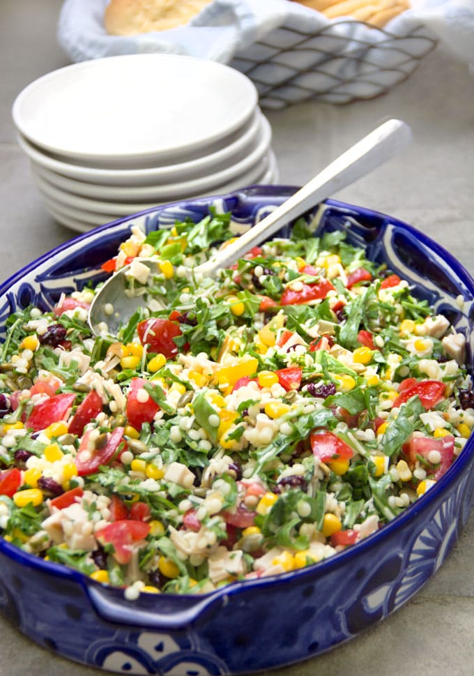 This is a wonderful main dish chopped salad recipe with a rainbow of healthy ingredients and a bright, tangy buttermilk dressing. Easily vegetarian or gluten-free | panningtheglobe.com