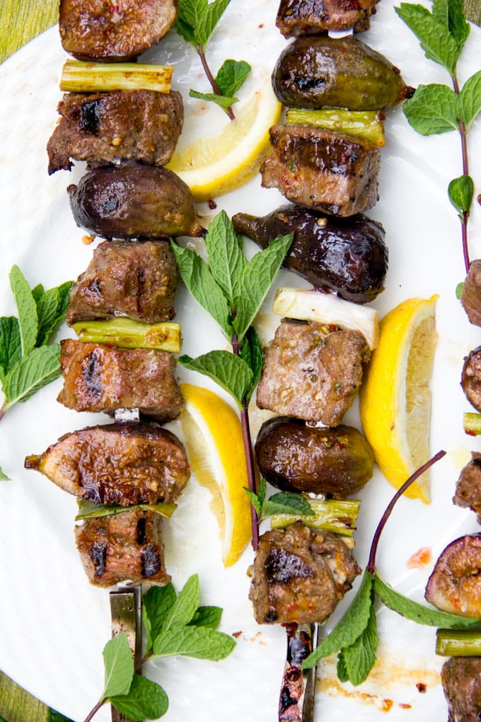 Grilled Lamb and Fig Skewers - Here's a kebab recipe for your next barbecue – grilled skewers of lamb and fresh figs with a sweet, spicy, minty glaze. The subtle sweet flavor of grilled figs is so delicious with the charred rich grilled lamb. The glaze takes it over the top.