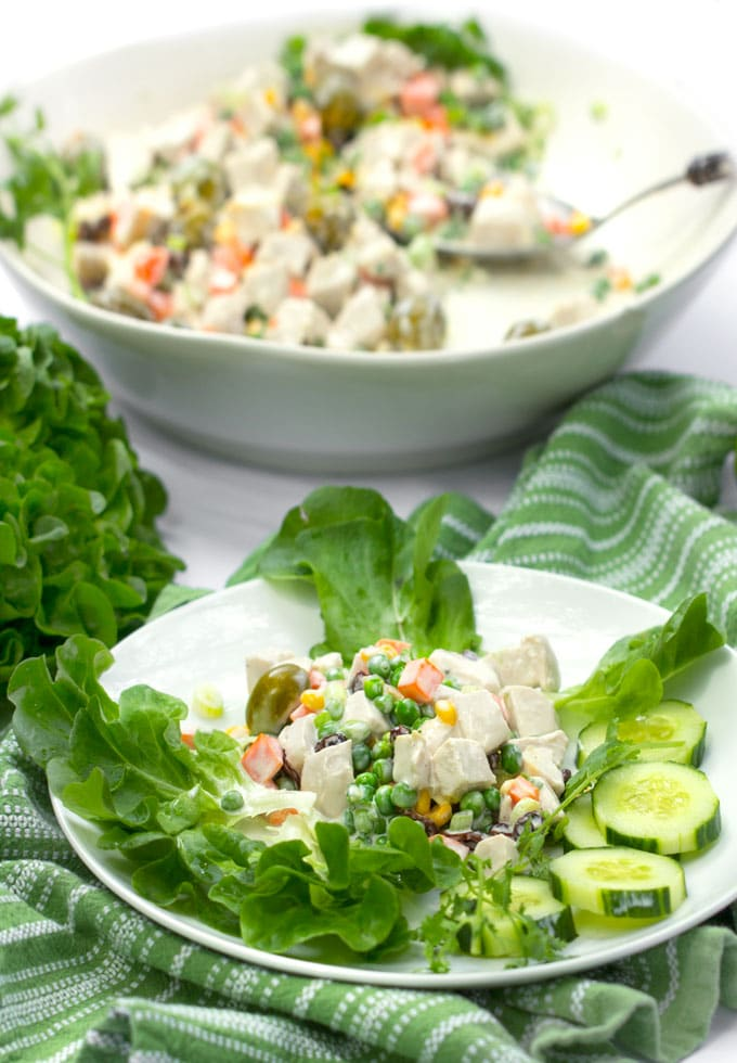 Salpicão is a famously delicious Brazilian chicken salad made with poached chicken, olives, raisins, green onions and spring vegetables in a tangy lime mayonnaise. It's festive and perfect for summer parties and picnics. The recipe is easy and you can do all the prep work ahead. Double or triple it if you're expecting a crowd.