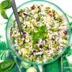 Mediterranean rice salad with fresh veggies and lemony dressing!This is my idea of theperfect summer side dish recipe. It's delicious at room temp, compliments almost any main dish and is especially great with anything grilled. Plus it's vegetarian and gluten-free.
