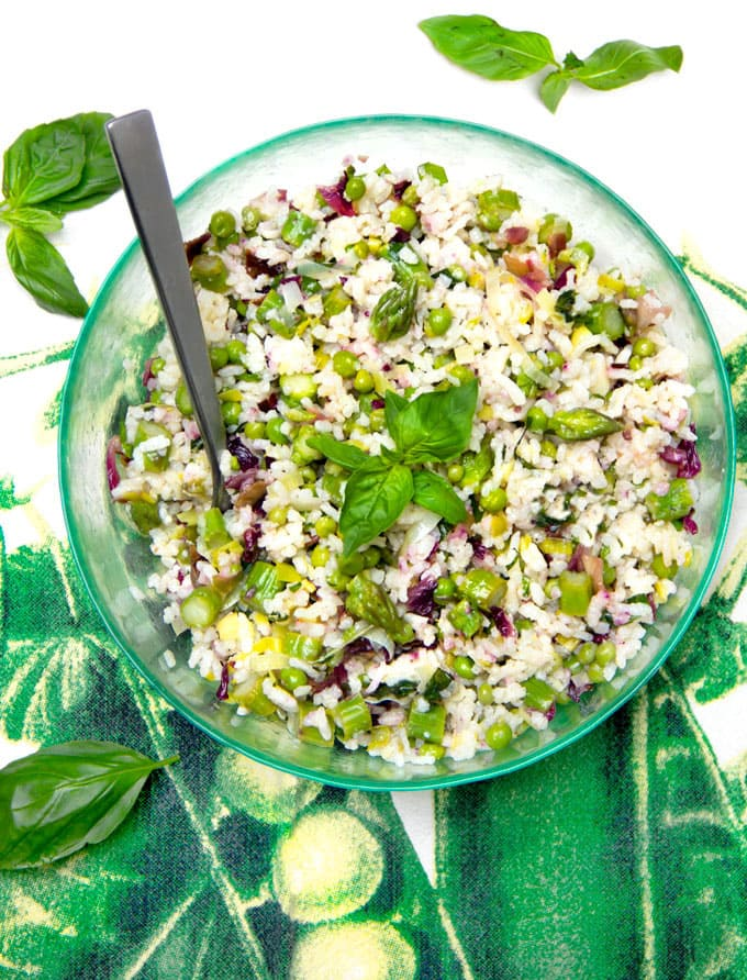 Mediterranean rice salad with fresh veggies and lemony dressing! This is my idea of the perfect summer side dish recipe. It's delicious at room temp, compliments almost any main dish and is especially great with anything grilled. Plus it's vegetarian and gluten-free.