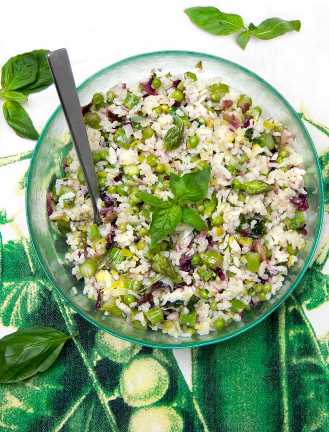 A delicious Mediterranean rice salad with lots of fresh veggies, Pecorino cheese and lemony dressing! This is my idea of the perfect summer side dish recipe. It complements almost any main dish and is especially great with anything grilled. Plus it's vegetarian and gluten-free.