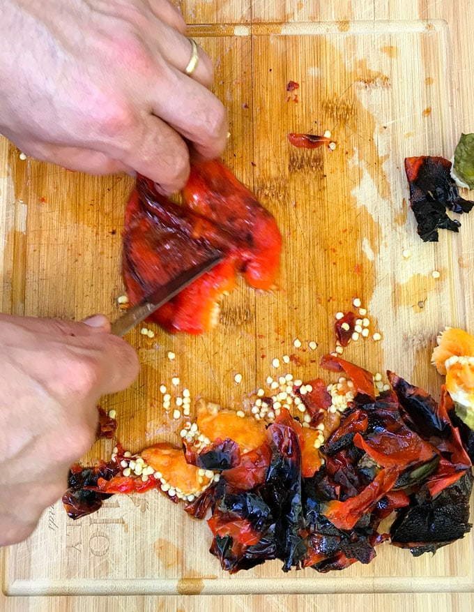 Roasted red peppers bear little resemblance to raw red bell peppers. The roasting process transforms them from firm and crunchy and to velvety soft and it brings out their natural sweetness. Whether you roast them in the oven or on the grill, the process is simple and totally satisfying. Homemade roasted peppers are exceptionally good - tender and fruity - way better than the kind you get in a jar.